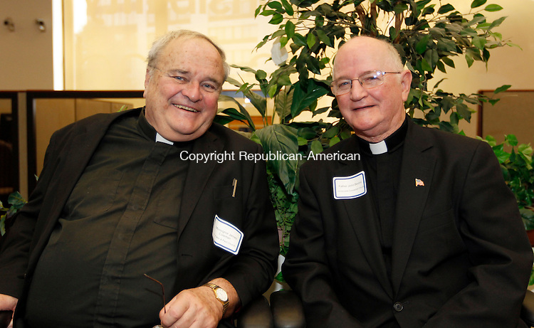 Waterbury, CT- 11, October 2010-101110CM12 SOCIAL MOMENT L-R Monsignor James Coleman (St. Peter and Paul) and Father John Bevins (Immaculate Conception Church)  at the Webster Bank 75th Anniversary in Waterbury. Christopher Massa Republican-American