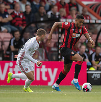 Bournemouth's Joshua King (right) under pressure from Sheffield United's Oliver Norwood (left) <br /> <br /> Photographer David Horton/CameraSport<br /> <br /> The Premier League - Bournemouth v Sheffield United - Saturday 10th August 2019 - Vitality Stadium - Bournemouth<br /> <br /> World Copyright © 2019 CameraSport. All rights reserved. 43 Linden Ave. Countesthorpe. Leicester. England. LE8 5PG - Tel: +44 (0) 116 277 4147 - admin@camerasport.com - www.camerasport.com