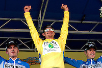 Floyd Landis (center), of Phonak Hearing Systems, celebrates winning the 2006 Ford Tour de Georgia in Alpharetta after Stage 6 on Sunday, April 23, 2006. Tom Danielson (right) and Yaroslav Popovych (left), both of the Discovery Channel Cycling Team, won second and third places, respectively. Juan Jos&eacute; Haedo of Toyota-United Pro won the 118.2-mile (190.2-km) stage from Cumming to Alpharetta.<br />