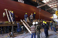 Workmen work frantically to get the Jeanie Johnston ready for transfer to the floating barge at Blennerville, Tralee yesterday.  The replica famine ship will sail to America in June and will be met by president Clinton in Washington..Picture by Don MacMonagle