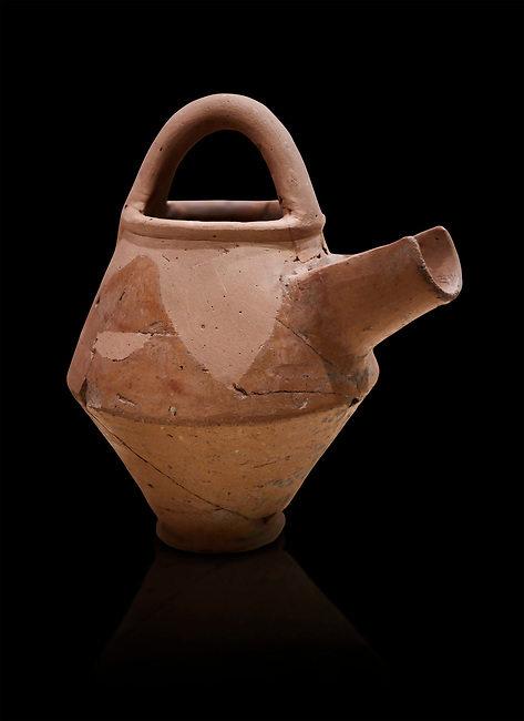 Hittite terra cotta side spout with stainer basket handles pitcher . Hittite Period, 1600 - 1200 BC.  Hattusa Boğazkale. Çorum Archaeological Museum, Corum, Turkey. Against a black bacground.