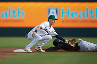 Augusta GreenJackets second baseman Jett Manning (13) waits for the throw as Ian Dawkins (8) of the Kannapolis Intimidators slides head-first into second base at SRG Park on July 6, 2019 in North Augusta, South Carolina. The Intimidators defeated the GreenJackets 9-5. (Brian Westerholt/Four Seam Images)