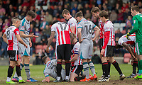 Play is stopped with Ben Davies of Grimsby and Kyle Storer of Cheltenham Town in the middle of a scramble for the ball during the Sky Bet League 2 match between Cheltenham Town and Grimsby Town at the The LCI Rail Stadium,  Cheltenham, England on 17 April 2017. Photo by PRiME Media Images / Mark Hawkins.