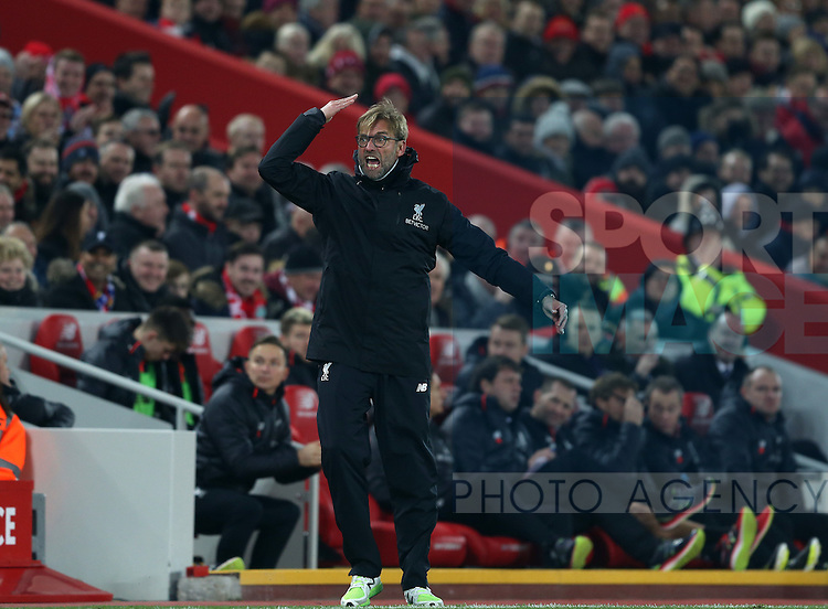 Jurgen Klopp manager of Liverpool tries to raise the crowd levelduring the Premier League match at the Anfield Stadium, Liverpool. Picture date: November 26th, 2016. Pic Simon Bellis/Sportimage