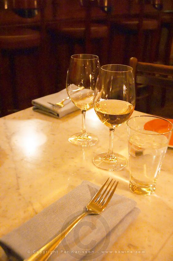 A table set for two with wine glasses and linen napkins and forks at the gastronomic restaurant Eriks Bakficka på Östermalm Stockholm, Sweden, Sverige, Europe