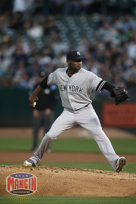 OAKLAND, CA - AUGUST 20:  Domingo German #55 of the New York Yankees pitches against the Oakland Athletics during the game at the Oakland Coliseum on Tuesday, August 20, 2019 in Oakland, California. (Photo by Brad Mangin)