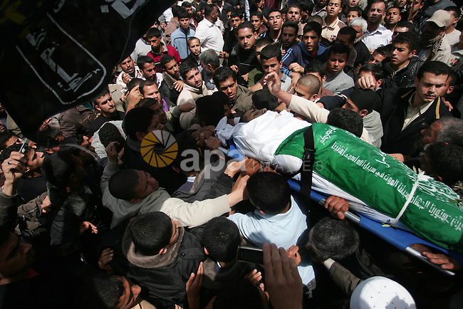 Palestinians carry the body of Hamas militant Abdallah Al Qarra during his funeral in Khan Younis, southern Gaza Strip, Friday, April 8, 2011. Israeli aircraft and ground forces struck Gaza on Friday in a surge of deadly fighting sparked by a Palestinian rocket attack on an Israeli school bus the day before. Just over two years after rocket fire from Gaza drew a devastating Israeli incursion in the territory, Israel and Gaza's Hamas rulers seemed poised on the brink of another round of intense violence. Photo by Mohammed Othman