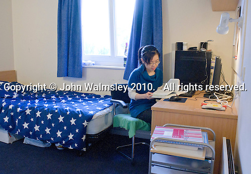English as a Foreign Language student working in her room in the Halls of Residence, Further Education College.