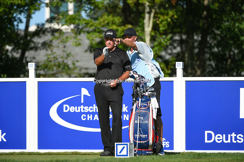 August 29, 2014 -  Norton, Mass. -  Phil Mickelson studies the 17th hole with his caddy during the first round of the PGA Deutsche Bank Championship held at the Tournament Players Club in Norton Massachusetts. Eric Canha/CSM