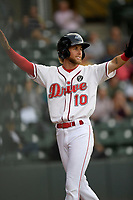 Center fielder Cole Brannen (10) of the Greenville Drive raises his arms after scoring a run in a game against the Hickory Crawdads on Wednesday, May 15, 2019, at Fluor Field at the West End in Greenville, South Carolina. Greenville won, 6-5. (Tom Priddy/Four Seam Images)