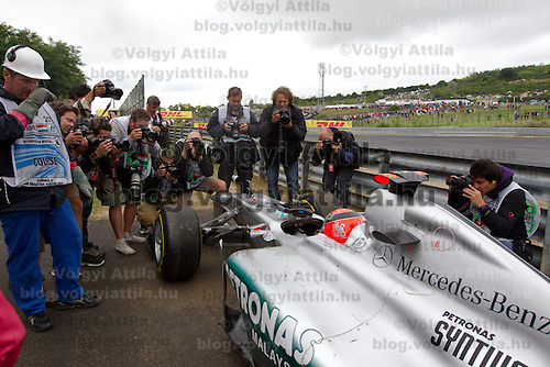 Photographers take pictures as Mercedes Formula One driver Michael Schumacher of Germany is forced to leave the race in a turn during the Hungarian F1 Grand Prix in Mogyorod (about 20km north-east from Budapest), Hungary. Sunday, 31. July 2011. ATTILA VOLGYI