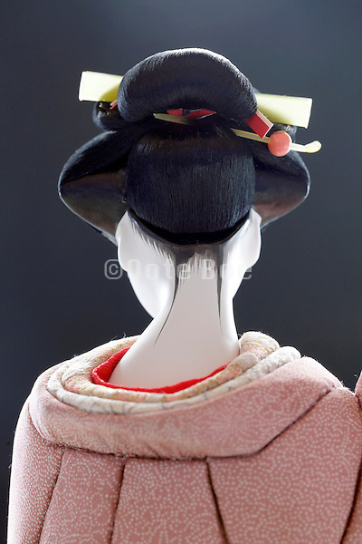 back side view of Japanese geisha doll