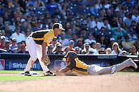 Alex Bregman of the USA Team fields the throw as Yoan Moncada of the World Team slides into third base during The Futures Game at Petco Park on July 10, 2016 in San Diego, California. World Team defeated USA Team, 11-3. (Larry Goren/Four Seam Images)