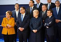 Angela Merkel, le Premier Ministre finlandais Juha Sipil&auml;, Dalia Grybauskaite,Pr&eacute;sidente de la R&eacute;publique de la Lituanie et le Pr&eacute;sident fran&ccedil;ais Emmanuel Macron lors de la photo de famille au Sommet europ&eacute;en &agrave; Bruxelles.<br /> Belgique, Bruxelles, 22 mars 2019 <br /> Chancellor of Germany Angela Merkel, Finland Prime Minister Juha Sipila, Lithuania President Dalia Grybauskaite, President of France Emmanuel Macron talk as they pose for a family photo during the European Union summit.<br /> Belgium, Brussels, 22 March 2019.