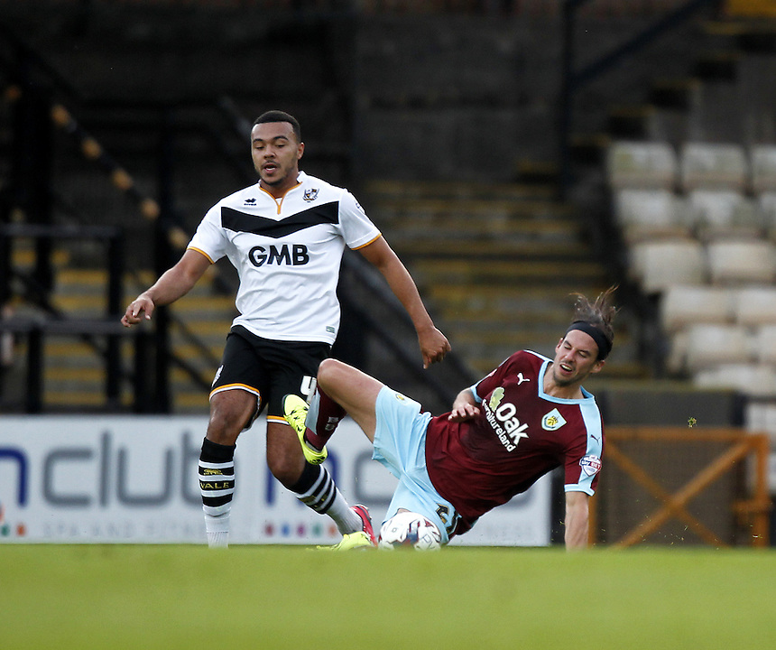 Burnley's George Boyd battles with  Port Vale's Remie Streete<br />
