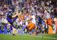 Jan. 4, 2010; Glendale, AZ, USA; TCU Horned Frogs punter (47) Anson Kelton kicks the ball against the Boise State Broncos in the 2010 Fiesta Bowl at University of Phoenix Stadium. Boise State defeated TCU 17-10. Mandatory Credit: Mark J. Rebilas-