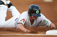 Kane County Cougars first baseman Marty Herum (14) slides head first into third during a game against the Great Lakes Loons on August 13, 2015 at Fifth Third Bank Ballpark in Geneva, Illinois.  Great Lakes defeated Kane County 7-3.  (Mike Janes/Four Seam Images)