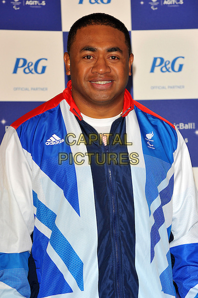 Derek Derenalagi.The Paralympic Ball in aid of the British Paralympic Association & the Agitos Foundation, Grosvenor House Hotel, Park Lane, London, England..September 5th, 2012.half length athlete blue white red tracksuit .CAP/CJ.©Chris Joseph/Capital Pictures.