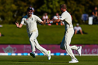 Stuart Broad celebrates with James Anderson of England  the wicket of Kane Williamson of the Black Caps during the final day of the Second International Cricket Test match, New Zealand V England, Hagley Oval, Christchurch, New Zealand, 3rd April 2018.Copyright photo: John Davidson / www.photosport.nz