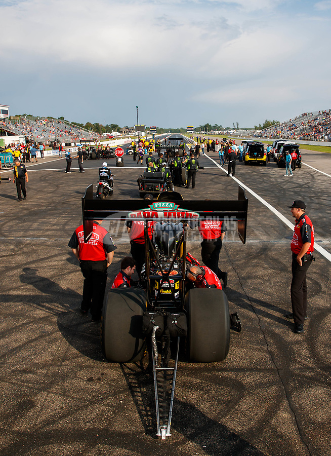 Aug 18, 2017; Brainerd, MN, USA; Crew members with NHRA top fuel driver Leah Pritchett during qualifying for the Lucas Oil Nationals at Brainerd International Raceway. Mandatory Credit: Mark J. Rebilas-USA TODAY Sports