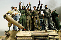 Baghdad, Iraq, April 6, 2003.Iraqi troops celebrating the destruction of a US Abrams tank in the Southern outskirts of Baghdad.