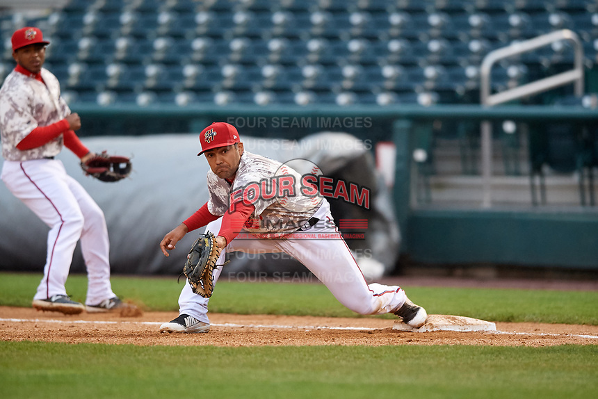 Harrisburg Senators first baseman Austin Davidson (8) stretches to receive a throw as second baseman Khayyan Norfolk (15) looks on during the second game of a doubleheader against the New Hampshire Fisher Cats on May 13, 2018 at FNB Field in Harrisburg, Pennsylvania.  Harrisburg defeated New Hampshire 2-1.  (Mike Janes/Four Seam Images)