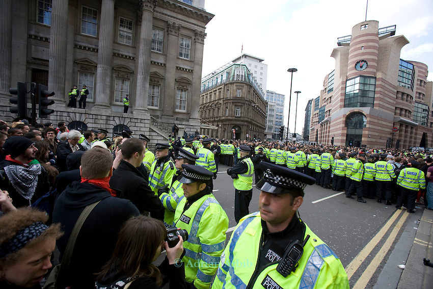 Police draw up the lines containing the protest. Many of the police had their numbers obscured.<br />