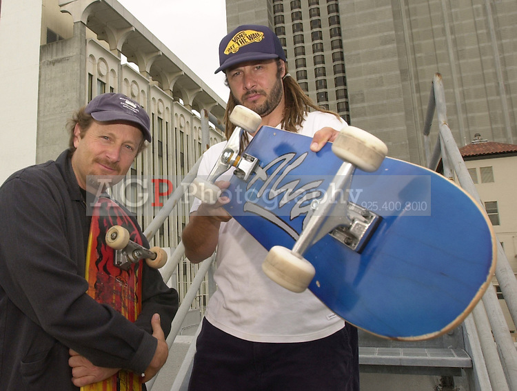 Apr 16, 2002 - San Francisco, California, USA - Skateboard pioneers STACY PERALTA, left, and TONY ALVA stand on the roof of a San Francisco Hotel during  a press juncket for their award winning documentary film DOGTOWN AND Z-BOYS that opens May 3. Alva and Peralta were instrumental in bringing skateboarding to the mainstream in the 1970's in Southern California. The film was awarded two awards at the Sundance film festival. (Credit Image: © Alan Greth)