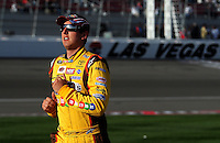 Feb. 27, 2009; Las Vegas, NV, USA; NASCAR Sprint Cup Series driver Kyle Busch runs to his car during qualifying for the Shelby 427 at Las Vegas Motor Speedway. Mandatory Credit: Mark J. Rebilas-