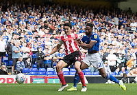 Luke O'Nien of Sunderland attempts to shield the ball from Janoi Donacien of Ipswich Town during Ipswich Town vs Sunderland AFC, Sky Bet EFL League 1 Football at Portman Road on 10th August 2019