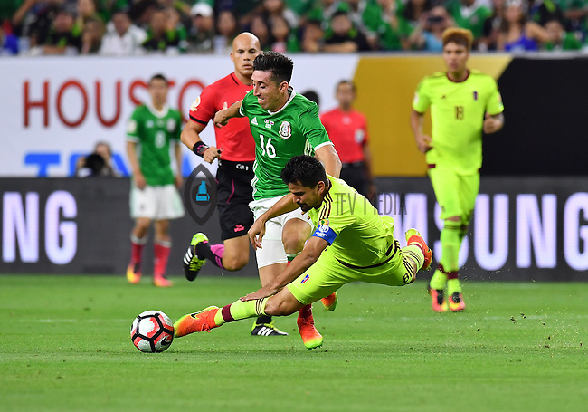 Mexico midfielder Hector Herrera (16) fouled Venezuela midfielder Tomas Rincon (8) during Copa America Centenario group C match, Monday, June 13, 2016 in Houston, Tex. Mexico draw Venezuela 1-1.(TFV Media via AP) *Mandatory Credit*