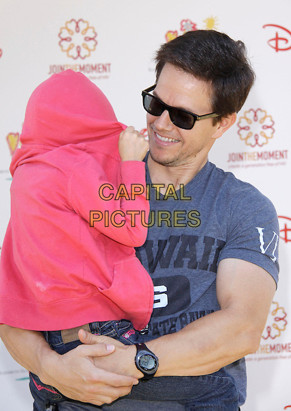 "ELLA RAE & MARK WAHLBERG.The 20th annual ""A Time for Heroes"" Celebrity Carnival benefiting Elizabeth Glaser Pediatric AIDS Foundation held at Wadsworth Theater on the Veteran Administration Lawn in West Los Angeles, California, USA. .June 7th, 2009.half length grey gray t-shirt carrying lifting daughter dad father family pink jacket sunglasses shades hiding covering face funny .CAP/DVS                                                  .©Debbie VanStory/Capital Pictures."