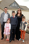 Jack Lawler with his parents Peter and Caroline, little sister Emma (5) and brother  Joey at his confirmation in the Star of the Sea Church, Mornington. Photo: www.newsfile.ie