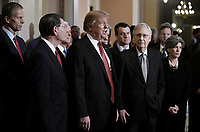 United States President Donald J. Trump talks to the press after the Republican Policy luncheon at the U.S. Capitol Building on January 9, 2019 in Washington, DC. Pictured from left to right: US Senator John Thune (Republican of South Dakota), US Senator John Barrasso (Republican of Wyoming), US Vice President Mike Pence, the President, US Senator Todd Young (Republican of Indiana), US Senate Majority Leader Mitch McConnell (Republican of Kentucky), and US Senator Joni Ernst (Republican of Iowa).<br /> Credit: Olivier Douliery / Pool via CNP /MediaPunch
