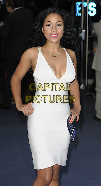 KATHRYN DRYSDALE .At the World Premiere of 'Inception' at the Odeon Leicester Square cinema, Leicester Square, London, England, .UK, July 8th 2010..arrivals half length white bandage body con dress hands on hips sleeveless cleavage .CAP/CAN.©Can Nguyen/Capital Pictures.