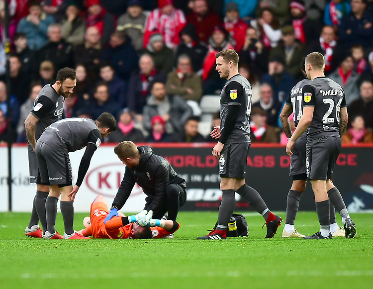 Lincoln City's Grant Smith receives treatment early in the game<br /> <br /> Photographer Andrew Vaughan/CameraSport<br /> <br /> The EFL Sky Bet League Two - Stevenage v Lincoln City - Saturday 8th December 2018 - The Lamex Stadium - Stevenage<br /> <br /> World Copyright © 2018 CameraSport. All rights reserved. 43 Linden Ave. Countesthorpe. Leicester. England. LE8 5PG - Tel: +44 (0) 116 277 4147 - admin@camerasport.com - www.camerasport.com