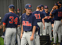 NWA Democrat-Gazette/ANDY SHUPE<br /> Ole Miss pitcher Zack Phillips walks to the playing surface Friday, June 7, 2019, during practice in The Fowler Family Baseball and Track Training Center ahead of today's NCAA Super Regional game at Baum-Walker Stadium in Fayetteville. Visit nwadg.com/photos to see more photographs from the practices.