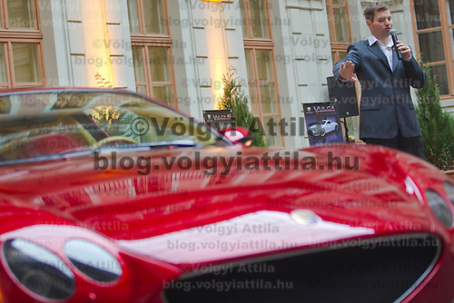 Press conference presenting the manually assembled Farralli & Mazzanti Vulca S luxury sports car to be produced in a limited series of ten pieces designed by Hungarian designer Zsolt Tarnok (right). Budapest, Hungary. Tuesday, 22. June 2010. ATTILA VOLGYI