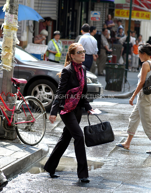 "Julianne Moore filming ""Laws of Attraction"" in New York. August 18, 2003. Please byline: NY Photo Press.   ..*PAY-PER-USE*      ....NY Photo Press:  ..phone (646) 267-6913;   ..e-mail: info@nyphotopress.com"