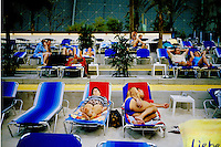 A couple slepping on the artificial beach inside the Tropical Island resort