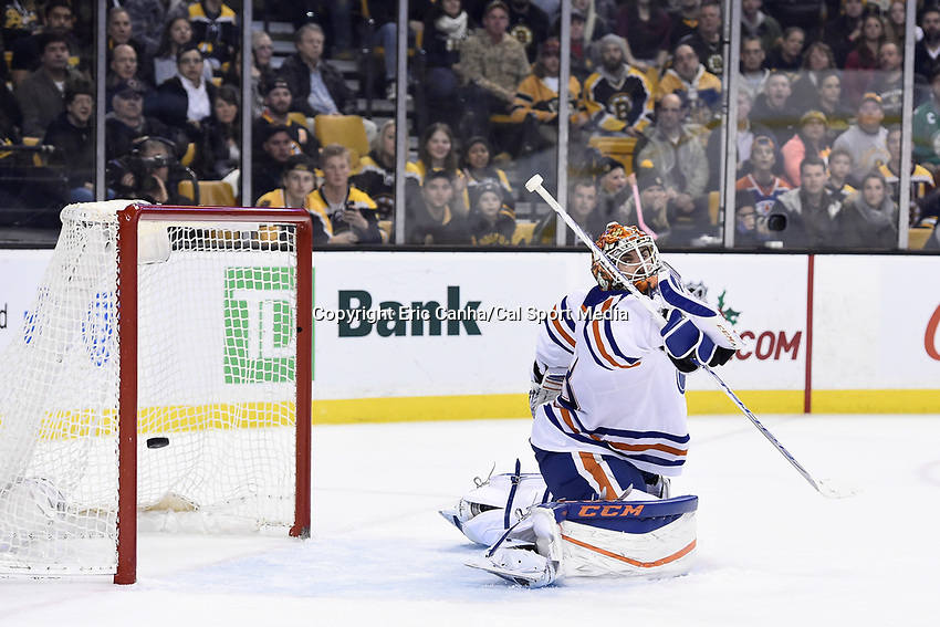 Monday, December 14, 2015: Edmonton Oilers goalie Cam Talbot (33) looks back as a shot by Boston Bruins left wing Brad Marchand (63) goes into the net during the National Hockey League game between the Edmonton Oilers and the Boston Bruins held at TD Garden, in Boston, Massachusetts. Edmonton defeats Boston 3-2 overtime. Eric Canha/CSM