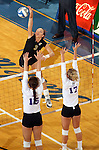 BROOKINGS, SD - NOVEMBER 9:  Kacey Hermann #3 from South Dakota State University tries for a kill past Jordan Jackson #15 and Sarah Fetter #17 from Western Illinois in the second game of their match Saturday at Frost Arena. (Photo by Dave Eggen/Inertia)