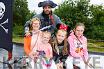 Noreen O'Brien, Molly, Aisling and Lily Gaynor and Alan Teahan (The Pirate) enjoying the Kilflynn Fairy Festival on Sunday.