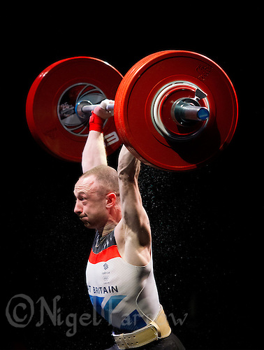 10 MAY 2014 - COVENTRY, GBR - Gareth Evans from the Holyhead and Anglesey Weightlifting and Fitness Club attempts to complete a lift during the men's 62kg category round at the British 2014 Senior Weightlifting Championships and final 2014 Commonwealth Games qualifying event round at the Ricoh Arena in Coventry, Great Britain (PHOTO COPYRIGHT © 2014 NIGEL FARROW, ALL RIGHTS RESERVED)