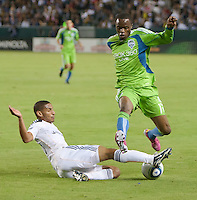 CARSON, CA – NOVEMBER 7:  LA Galaxy defender Sean Franklin (28) and Seattle Sounders midfielder Steve Zakuani (11) during a playoff soccer match at the Home Depot Center, November 7, 2010 in Carson, California. Final score LA Galaxy 2, Seattle Sounders 1.