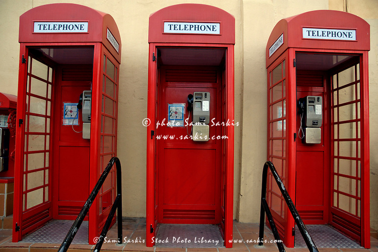 Three old-fashioned public telephone boxes in Gibraltar, British Overseas Territory, England.