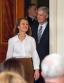 Judge Neil Gorsuch aand his wife, Marie Louise, come into the East Room from the Green Room as United States President Donald J. Trump announces Judge Gorsuch as his nominee to be Associate Justice of the US Supreme Court to replace Justice Antonin Scalia in the East Room of the White House in Washington, DC on Tuesday, January 31, 2017.<br /> Credit: Ron Sachs / CNP