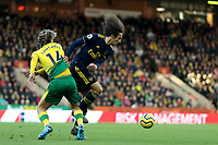 1st December 2019; Carrow Road, Norwich, Norfolk, England, English Premier League Football, Norwich versus Arsenal; Matteo Guendouzi of Arsenal takes on Todd Cantwell of Norwich City - Strictly Editorial Use Only. No use with unauthorized audio, video, data, fixture lists, club/league logos or 'live' services. Online in-match use limited to 120 images, no video emulation. No use in betting, games or single club/league/player publications