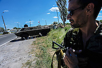A member of Russian Orthodox Army seen at one of the checkpoints south-east of Donetsk.