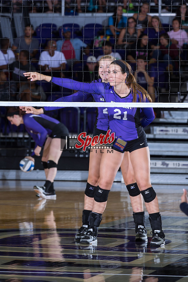 Camryn Freiberg (21) and Haley Barnes (20) of the High Point Panthers during the match against the UNC Greensboro Spartans at Millis Athletic Center on September 16, 2014 in High Point, North Carolina.  The Panthers defeated the Spartans 3-0.   (Brian Westerholt/Sports On Film)